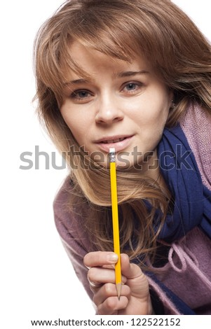 Portrait of an young beautiful girl holding a pencil, isolated on white