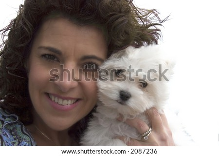 Portrait of an young woman and her toy-puppy