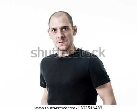 Portrait of angry and upset young man looking furious, aggressive and crazy in People and human emotions, facial expressions and abuse, violence and bullying concept. Isolated on white background.