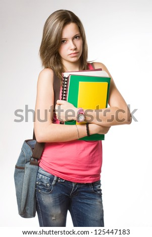 Portrait of angry, frustrated looking young student girl. - stock photo