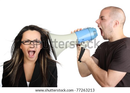 Portrait of angry man shouting at his secretary through megaphone who is indifferent to it