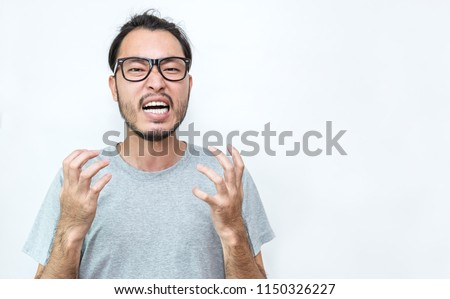 Portrait of angry pensive mad crazy asian nerd glasses man scream out. Closeup Young asian nerdy man isolate on white background. Stress burnout office syndrome over load work hard office male concept