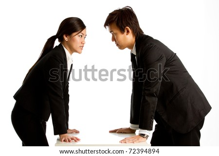 Portrait of angry people against white background