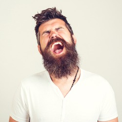 Portrait of angry screaming man. Screaming bearded brutal. Feeling angry. Stressed furious bearded man shouting. Face expression. Crazy man with beard. Negative emotions, problems.