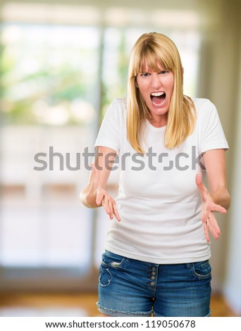 Portrait Of Angry Woman in her living room, indoors