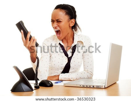 portrait of angry woman screaming at the phone - stock photo