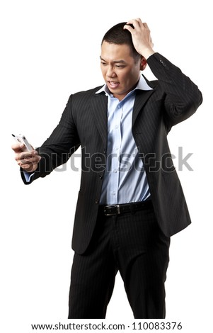 portrait of angry young man shouting using mobile over white background