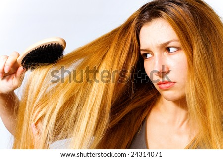 Portrait of annoyed woman with hair problem