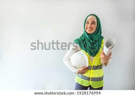 Portrait of Arab architects. Muslim woman architect isolated in gray background. Muslim female architect  looking at camera. Architect Young Muslim women at work.