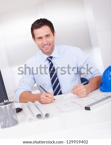 Portrait Of Architect With Blueprint In The Office
