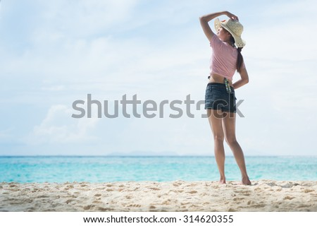 portrait of Asia young woman standing on the beach #314620355