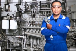 Portrait of Asian an mechanic engineer with machine background