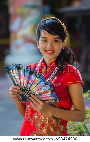 9df22a281 Beautiful Asian girl with Chinese traditional dress Cheongsam ...