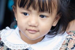 Portrait of asian baby girl, Face looking glancing with a smile