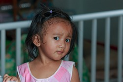 Portrait of asian baby girl toddler, Face looking glancing at camera  in home