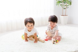 portrait of asian baby playing in the room