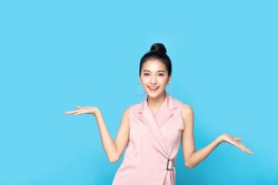 Portrait of Asian beautiful young woman show both hands with open palms on upper side with smile face. Girl presenting and advertising comparison and balance. Advertisement & presentation concept.