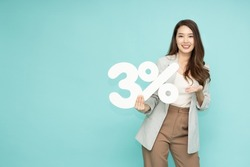 Portrait of Asian business woman showing and holding 3% number or three percent isolated over green background