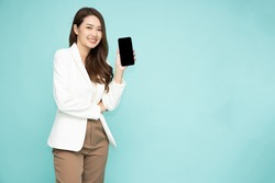 Portrait of Asian business woman showing or presenting smartphone or mobile phone application isolated over green background, Asian Thai model