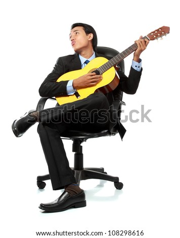 portrait of asian businessman playing guitar on the chair