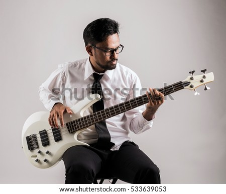 portrait of asian businessman playing guitar on the chair #533639053