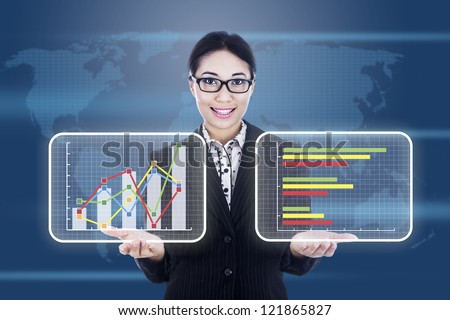 Portrait of asian businesswoman showing business chart on a graphic interface
