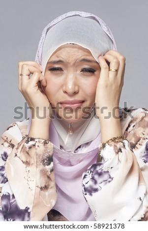Portrait of Asian Businesswoman with Headache
