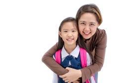 Portrait of asian child in school uniform hugging with mother on white background isolated