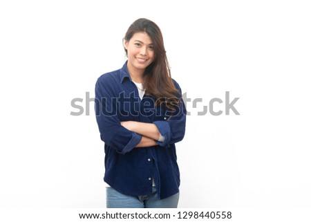 Portrait of  Asian college student smiling with arms folded looking at camera isolated on white background - Image  #1298440558