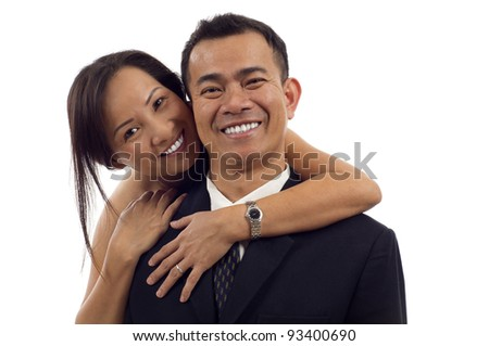 Portrait of Asian couple hugging and smiling isolated over white background