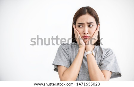 Portrait of asian female feeling painful toothache. Teeth problem panic drama woman feeling tooth pain. Closeup of beautiful sad girl suffer from tooth pain. Dental healthcare stressful concept.