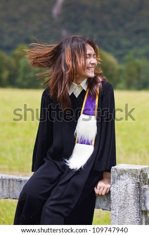 Portrait of Asian female graduate in Thailand