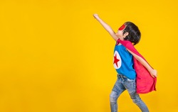 Portrait of asian little boy playing pretend to superhero. Happy young cut boy wearing hero costume, education childhood lifestyle, back to school and rescue the world in peace concept