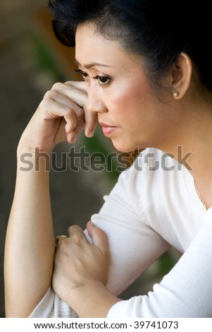 stock photo : portrait of asian mature woman in sorrow having a serious ...