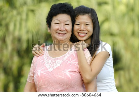 portrait of asian mother and daugther - stock photo