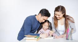 Portrait of Asian Mother Father teaching daughter learn to write color on book, Asian parents helping little girl do homework. Education art work love together home school family day concept