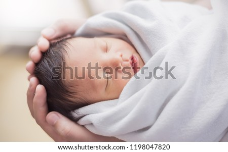 Portrait of asian parent hands holding newborn baby fingers, Closeup mother's hand holding their new born baby. Love family healthcare and medical body part nursery together happy mother's day concept