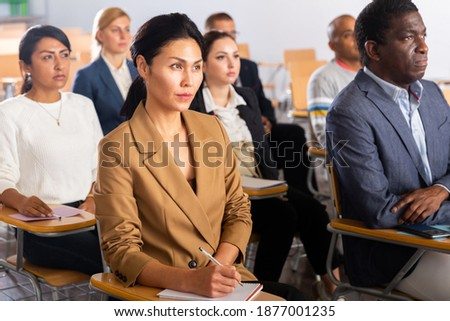 Portrait of asian woman attending business training, listening with interest to speaker Photo stock ©