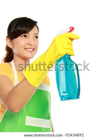 portrait of asian woman holding a sprayer. ready for cleaning