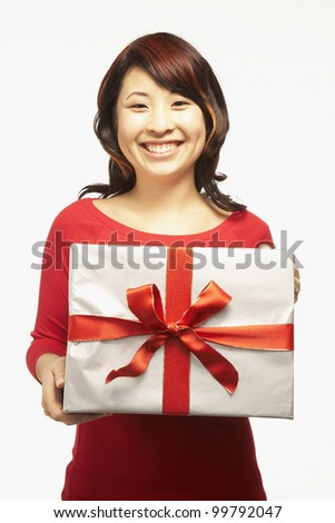Portrait of Asian woman holding gift