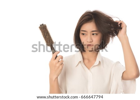 Photo of Portrait  of asian woman long hair with a comb and problem hair on white background, Free form copy space.This image for hair loss concept.