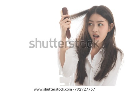 Photo of Portrait  of asian woman long hair with a comb and problem hair on white background. This image for hair loss concept. Free from copy space.