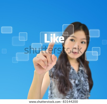 Portrait of asian woman pressing like button on a flow of buttons