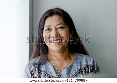 Portrait of asian woman 60s smile looking camera at home during covid19 coronavirus.Stay home and Lockdown.Senior christian woman. Senior Adult Women Smiling happy with retirement life.Dental care.