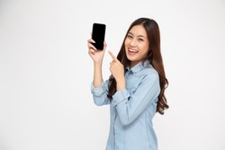 Portrait of Asian woman showing or presenting mobile phone application and pointing finger to smartphone on hand isolated over white background, Asian Thai model