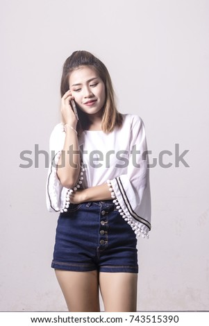 portrait of asian woman using smartphone on white background. #743515390