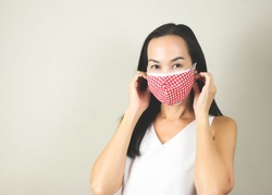 Portrait of Asian woman wearing  double face masks or two face masks to protect from coronavirus or covid-19 outbreak. concept of safety, healthcare, medical and hygiene.