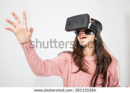 portrait of asian woman wearing virtual reality goggle