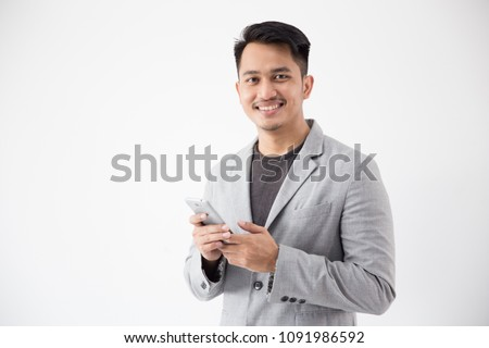 portrait of Asian Young Business man with smart cell phone