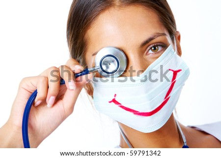 Portrait of assistant in mask with big smile on it looking at camera